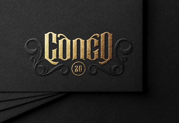 Maquete de logotipo de luxo no cartão preto Psd Premium