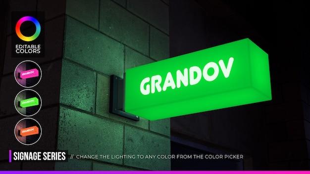 Maquete de logotipo de sinalização retangular na fachada ou loja com iluminação noturna Psd Premium
