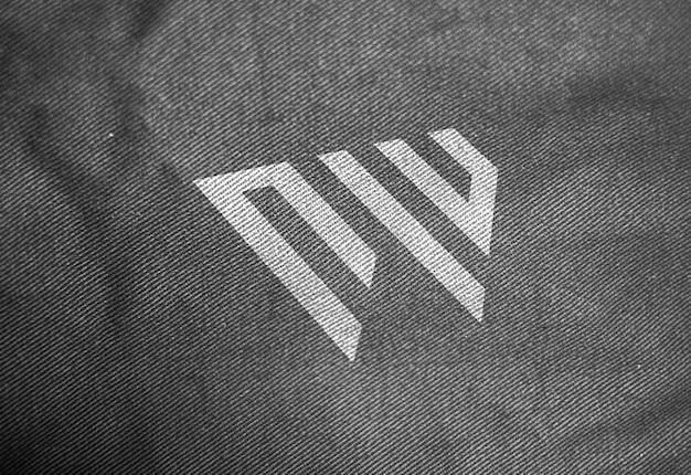 Maquete de logotipo de textura de tecido escuro Psd Premium