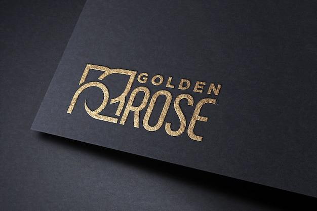 Maquete de logotipo dourado no papel Psd Premium