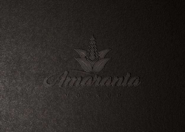 Maquete de logotipo na textura de couro Psd Premium