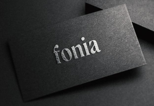 Maquete de logotipo no cartão preto Psd Premium