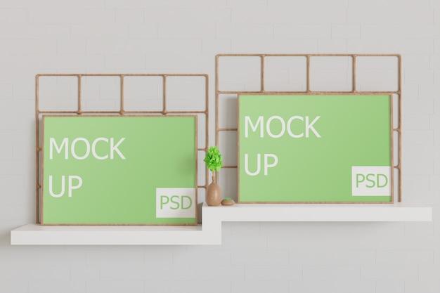 Maquete de madeira com moldura de paisagem na mesa de parede branca Psd Premium
