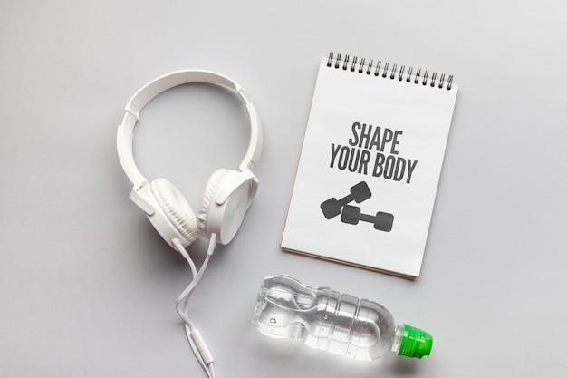 Maquete de mensagem de fitness e fones de ouvido Psd grátis