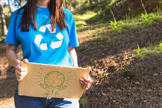 Maquete de papelão com eco e conceito de voluntário Psd grátis