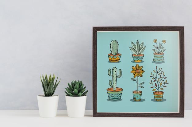 Maquete de quadro ao lado de plantas Psd grátis