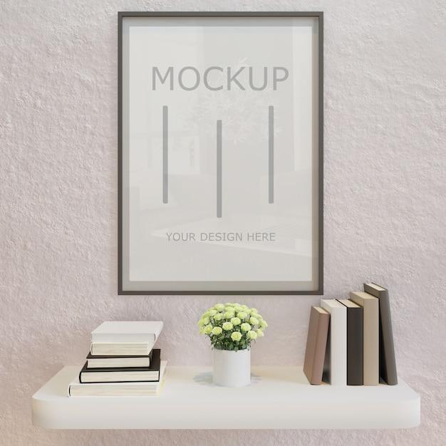 Maquete de quadro cartaz horizontal na parede branca com estante de parede do livro Psd Premium
