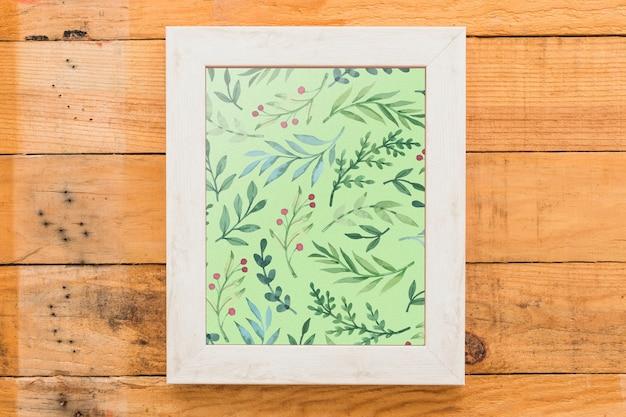 Maquete de quadro em fundo de madeira Psd grátis