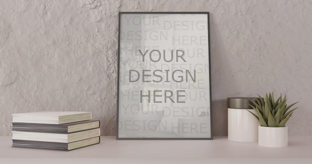 Maquete de quadro preto em pé na mesa branca. quadro horizontal com livros e suculentas Psd Premium