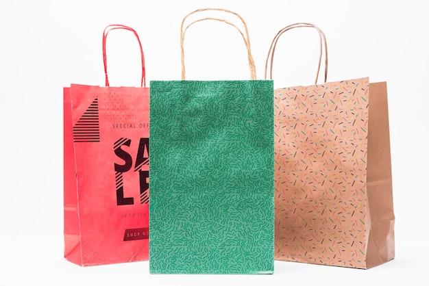 Maquete de sacola de compras em cores diferentes Psd grátis