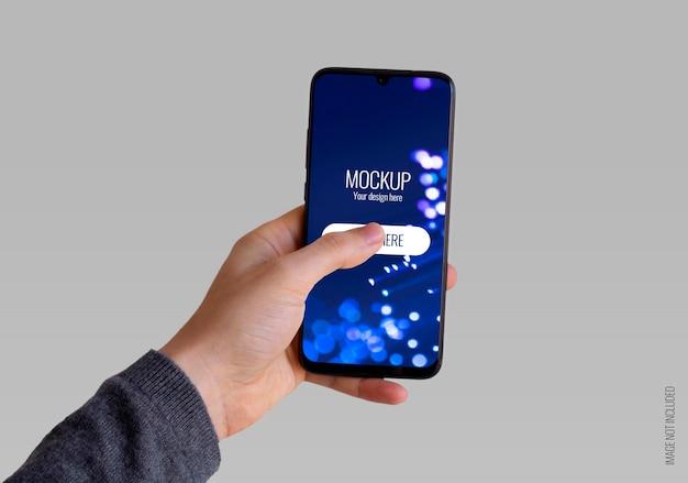 Maquete de smartphone segurando a mão esquerda Psd grátis