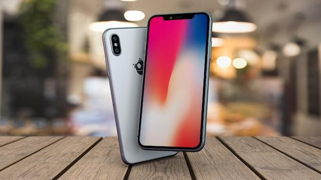 Maquete de smartphones na mesa Psd Premium