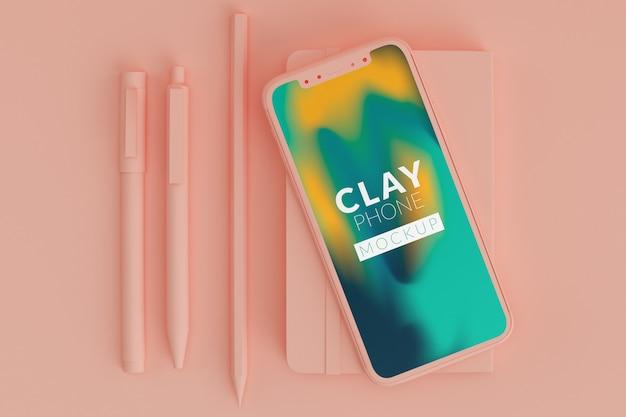 Maquete de telefone de barro rosa Psd Premium