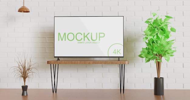 Maquete de tv vista frontal sobre a mesa Psd Premium