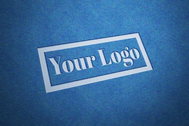Maquete do logotipo com textura de tecido jeans Psd Premium