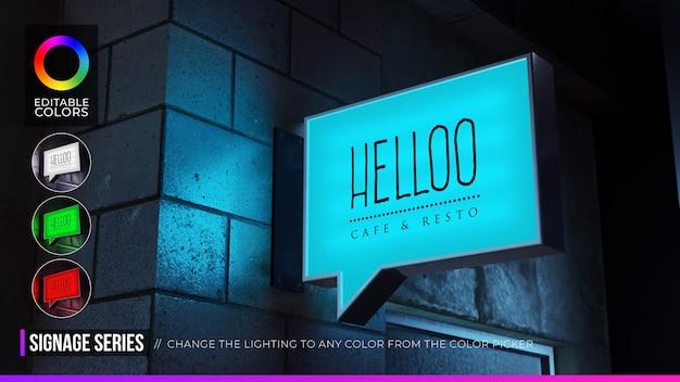 Maquete do logotipo de sinalização de bolha de discurso retangular na fachada ou no café da loja Psd Premium
