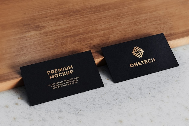 Maquete do logotipo do cartão de visita realista ouro preto texturizado Psd Premium