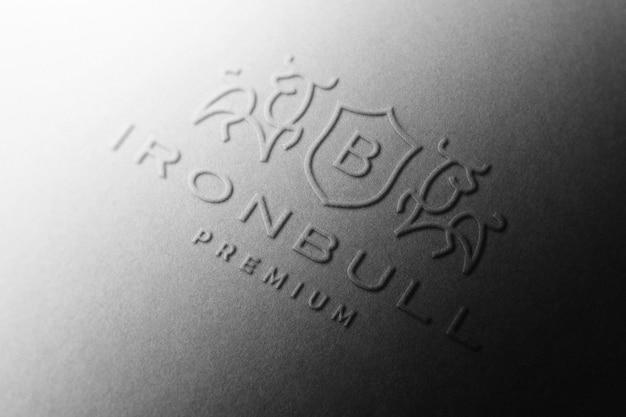 Maquete do logotipo em relevo em papel preto Psd grátis