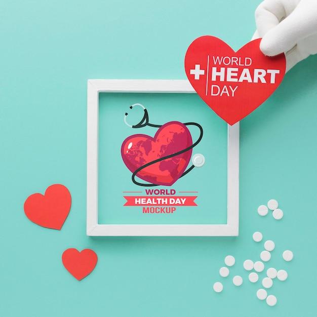 Maquete e coração do dia mundial da saúde plana leigos Psd grátis
