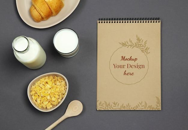 Maquete em branco com leite e flocos em fundo preto Psd Premium