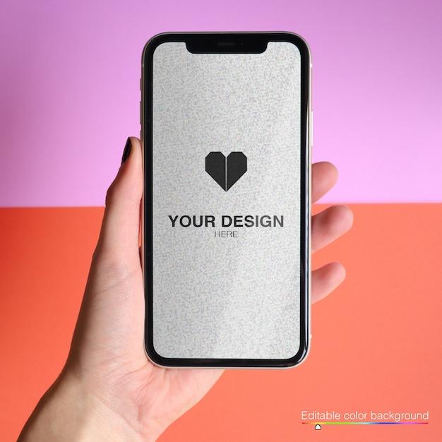 Maquete para telefone com fundo de cor editável Psd Premium