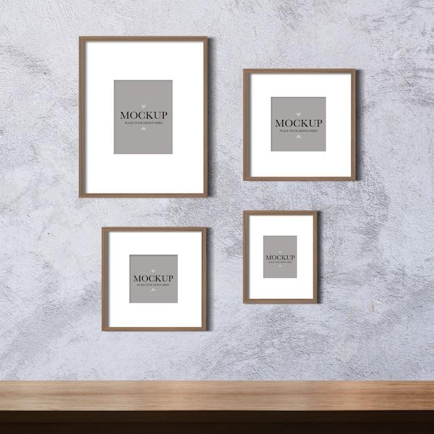 Maquete quatro molduras em branco na parede de cimento Psd Premium