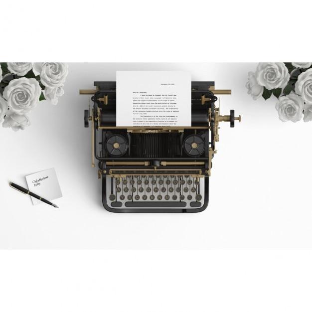 Máquina de escrever velha em um desktop com rosas brancas Psd grátis