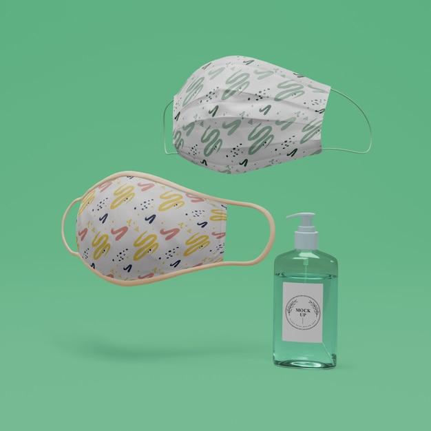 Máscaras artesanais e desinfetante para as mãos com maquete Psd grátis