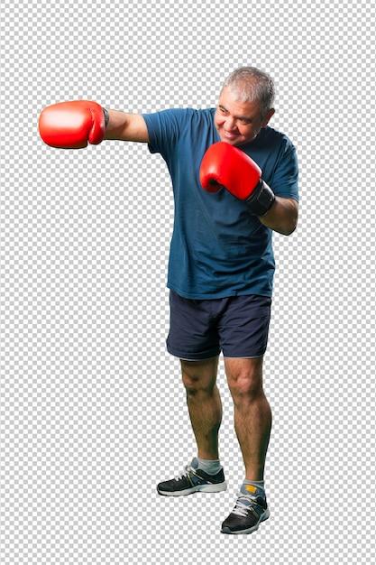 Meio envelhecido homem socar com luvas de boxe, corpo inteiro Psd Premium