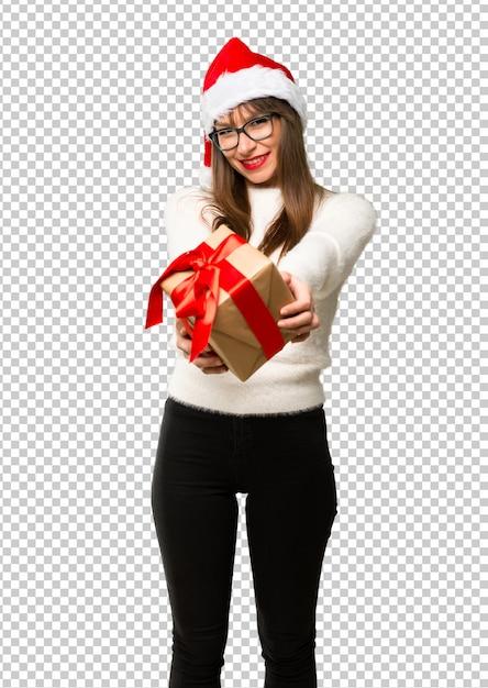 Menina, com, celebrando, a, natal, feriados, segurando, caixas presente, em, mãos Psd Premium