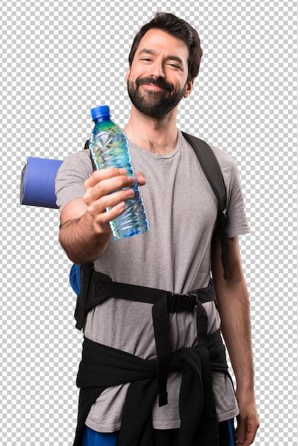 Mochileiro bonito feliz com uma garrafa de água Psd Premium