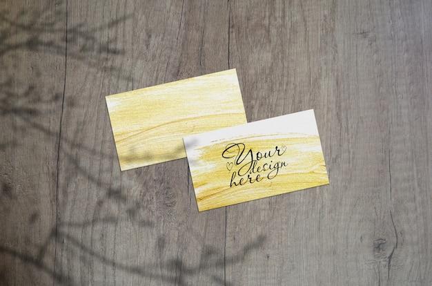 Mock-se de cartões de visita com sombras de plantas Psd Premium