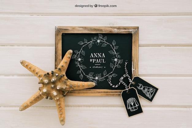 Mock up design com quadro-negro, etiquetas e estrela do mar Psd grátis