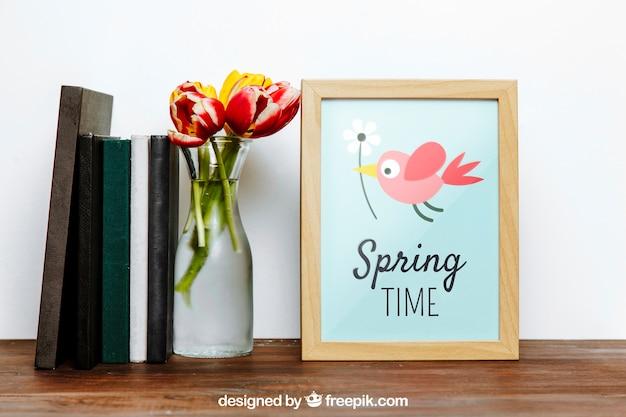 Mockup de moldura de primavera com livros e vasos de flores Psd grátis