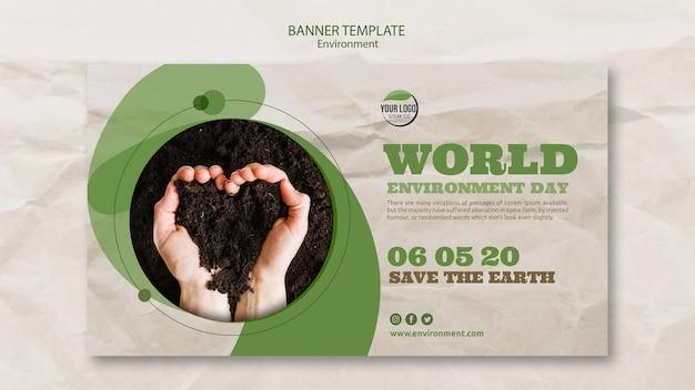 Modelo de banner do mundo ambiente dia com solo em forma de coração Psd grátis