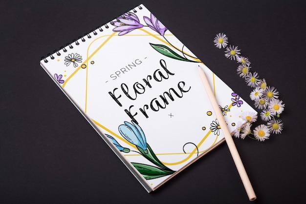Modelo de bloco de notas para a primavera com flores Psd grátis