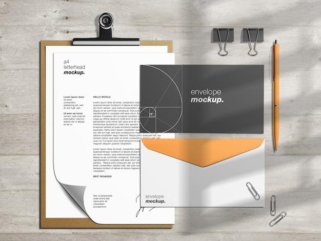 Modelo de maquete de identidade corporativa profissional de papelaria e criador de cena com papel timbrado e envelopes de clipe de papel Psd Premium