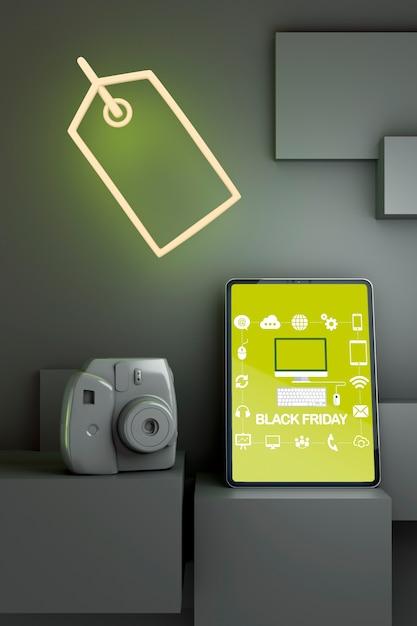 Modelo de tablet sexta-feira negra com luzes de neon amarelas Psd grátis