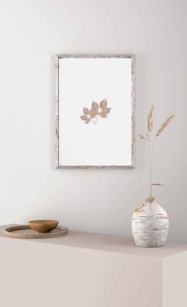 Moldura na parede com flor em vaso Psd grátis