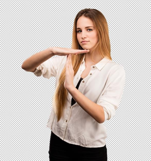 Muito jovem, fazendo o gesto de intervalo de tempo Psd Premium