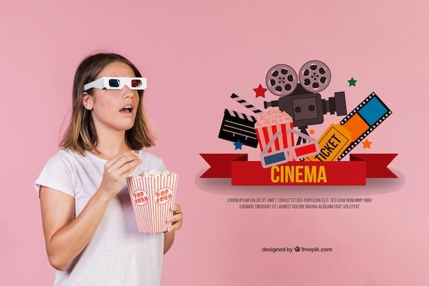 Mulher jovem e bonita comendo pipoca com óculos 3-d ao lado de elementos de cinema desenhados à mão Psd grátis