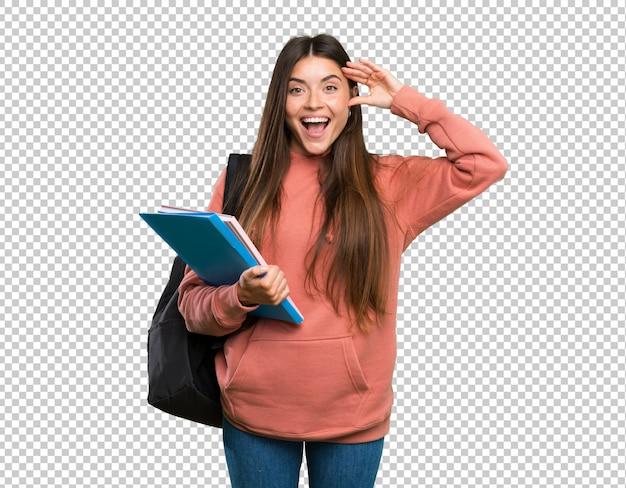 Mulher jovem, estudante, segurando, cadernos, com, expressão surpresa Psd Premium