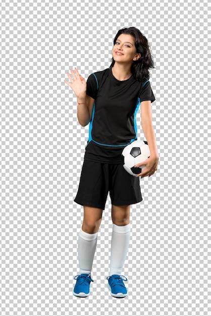 Mulher jovem, jogador de futebol, saudando, com, mão, com, feliz, expressão Psd Premium