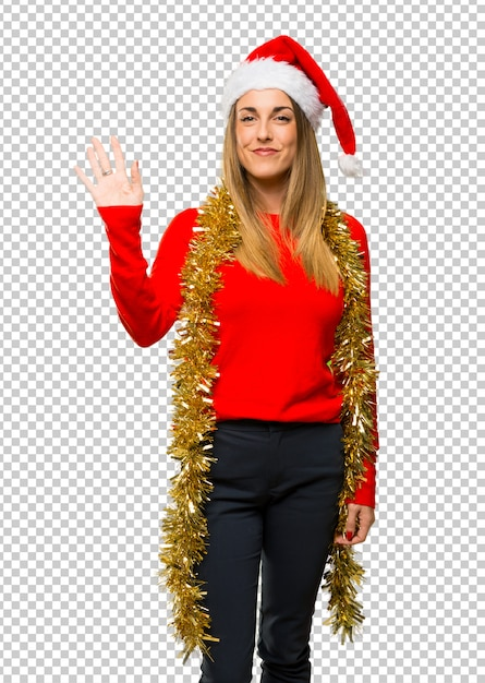 Mulher loira vestida para as férias de natal Psd Premium