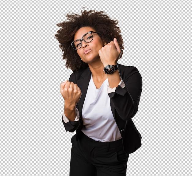 Mulher negra de negócios fazendo gesto de soco Psd Premium