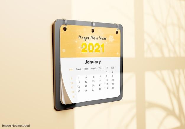 Nota de calendário realista pendurada em maquete de parede Psd Premium