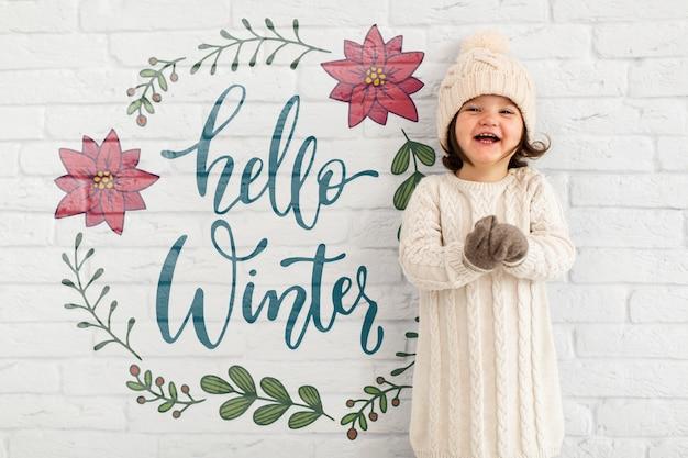 Olá maquete de inverno com criança adorável Psd grátis
