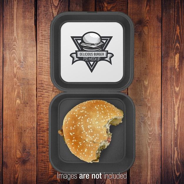 Open burger black box com meio hamburguer Psd Premium
