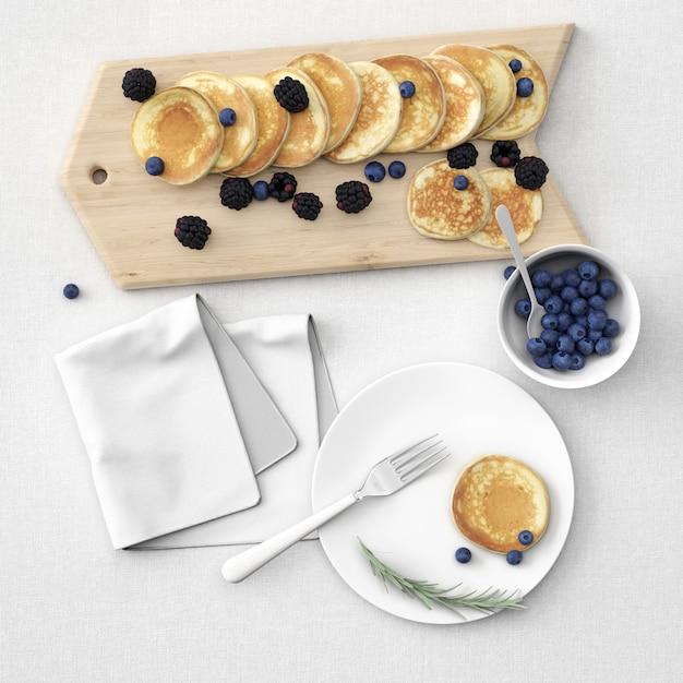 Panquecas a bordo e prato com frutas Psd grátis