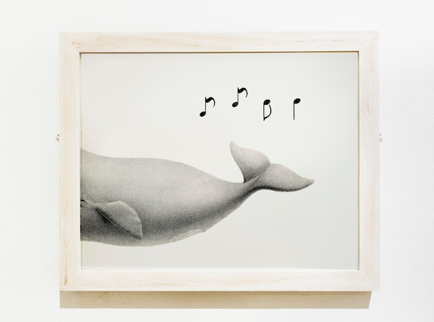 Pedaço de arte emoldurado de uma baleia cantando Psd grátis